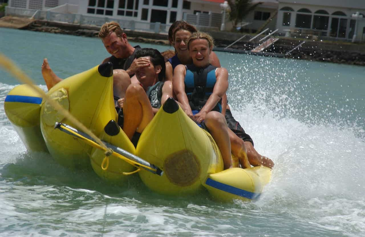 Banana-rides-are-rides-on-an-inflatable-boat-that-looks-like-a-banana-and-then-these-banana-boats-are-fastened-to-a-speed-boat-which-pulls-it-on-the-water-at-high-speeds